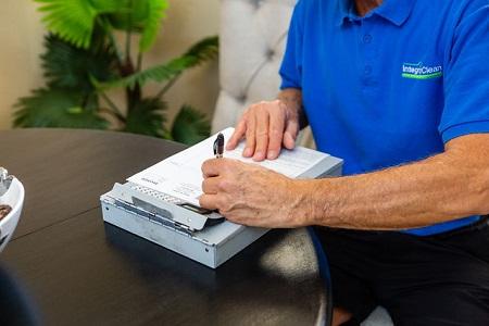 Technician Writing Up a Job Invoice