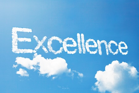 The Word Excellence Written In The Sky with White Smoke